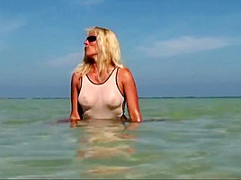 Hot milf posing in wet see through bikini on the beach part2