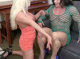 Two muscle women play with their huge clits