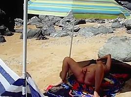 A mature nudist masturbates filmed