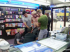 Two thugs drag a businessman into a porn shop and strip him of his manhood.
