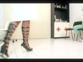 Busty white MILF nurse giving patient a sexy foot job
