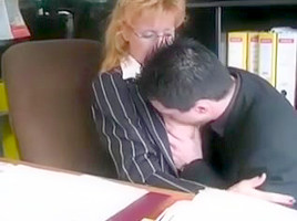 Horny mature secretary seduced by a younger client